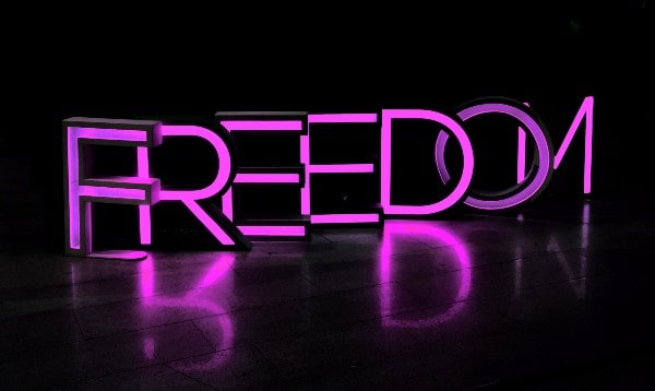 Bright pink freedom sign black backgrounds