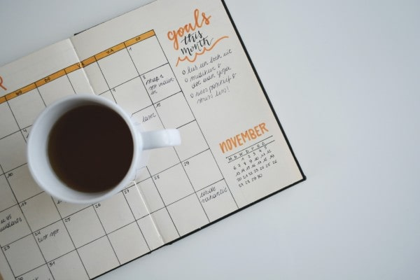 Bullet journal with cup of coffee