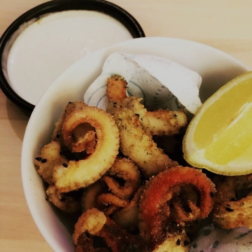 Deep fried octopus with creme fraiche sauce and lemon