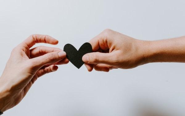 Paper heart between two hands