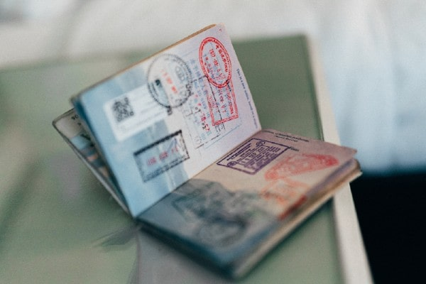 Passport with visa and immigration stamps