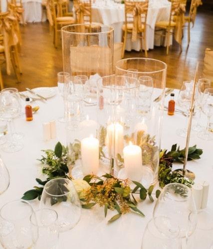 Wedding reception table candles wreath