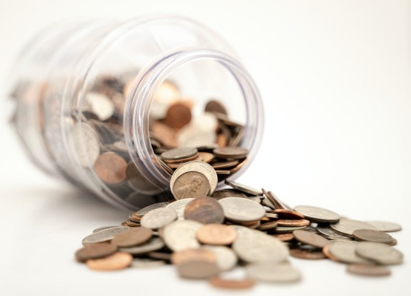 Jar with coins spilling out